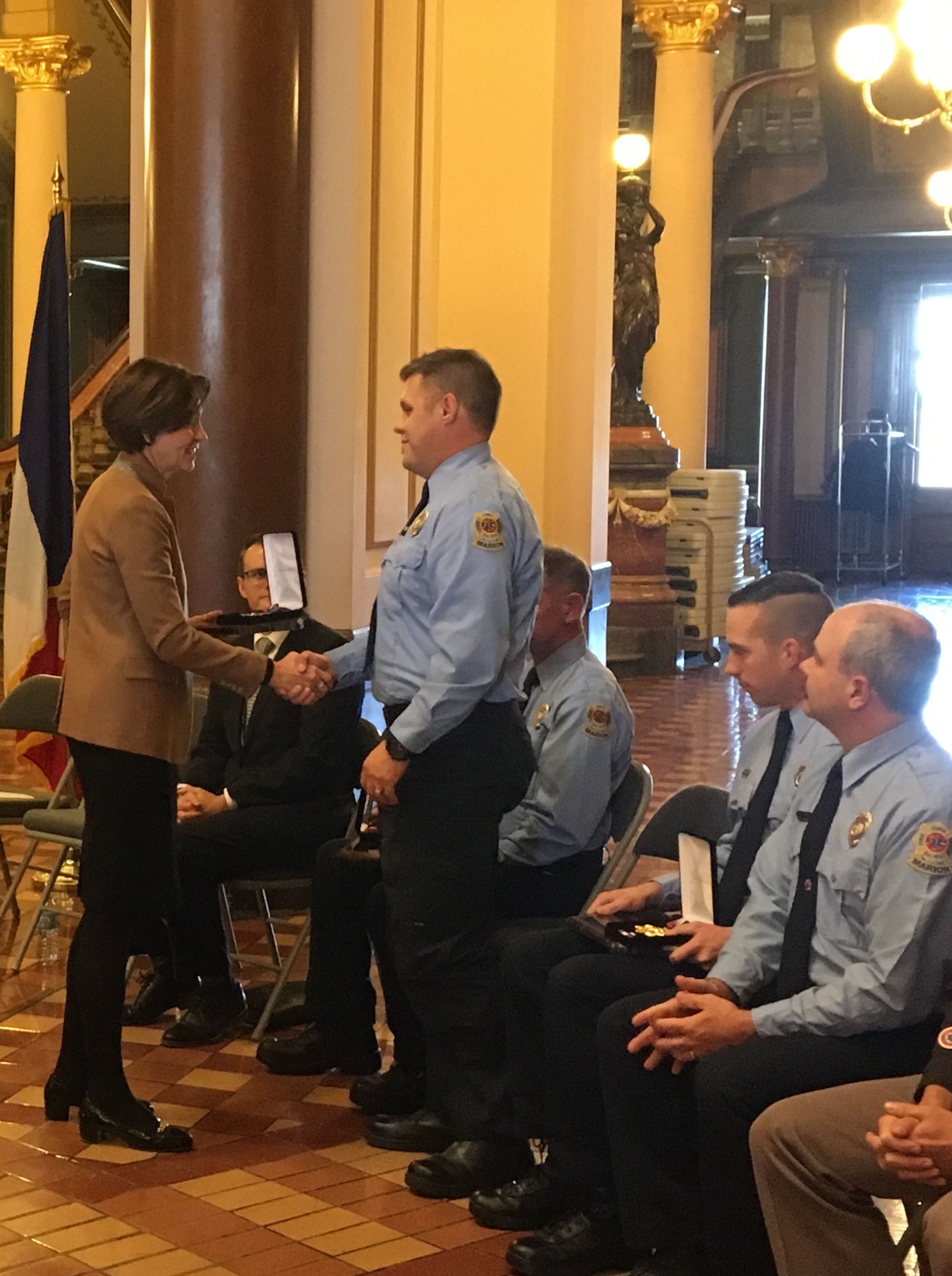 marion firefighters receiving award from governor reynolds
