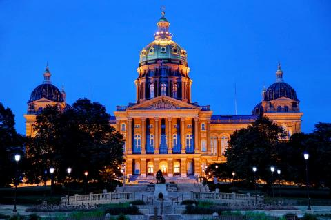 Iowa State Capitol at night.